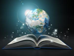 An image of the Planet Earth above an open book