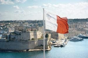 Maltese flag flying from upper Barrakka gardens in Valletta.