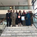 Delegates of the Arab World Meeting pose on the steps of the Library